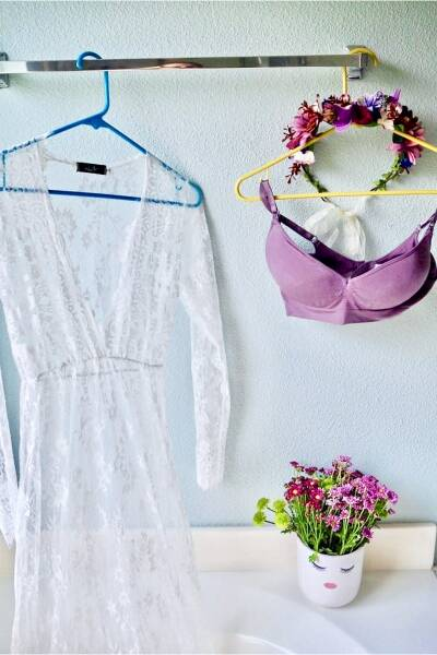 Sheer lace gown and purple bohemian crown with purple bra for a vegan milk bath photo shoot