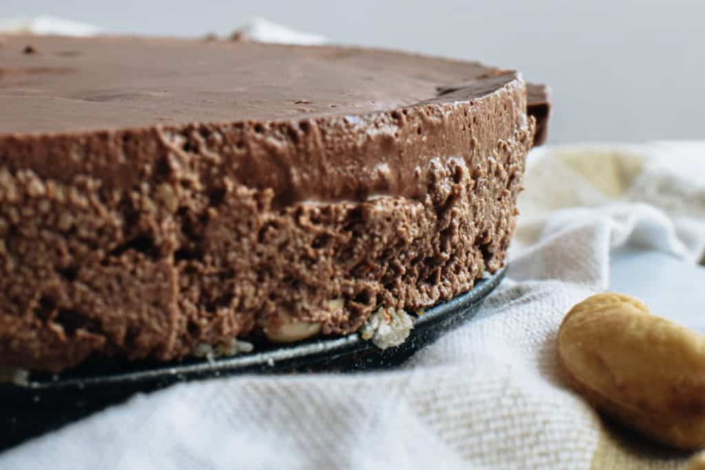 closeup of chilled raw chocolate cake still in cake pan